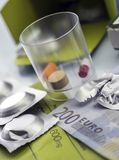 Pastilla effervescent next to medication daily on a ticket. Of 200 euros, concept of copayment health Stock Photos