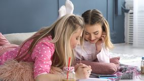 Pastime friends communication teenage mates. Friendship bff. fun leisure pastime. friends communication. young teenage mates at home drawing in the notebook Stock Photo