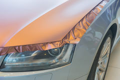 Pasting of car carbonic plastic. Closeup Royalty Free Stock Images