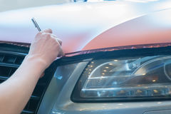 Pasting of car carbonic plastic. Closeup Royalty Free Stock Photos