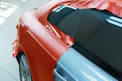 Pasting of car carbonic plastic. Closeup stock photography