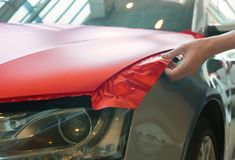 Pasting of car carbonic plastic. Closeup royalty free stock photography