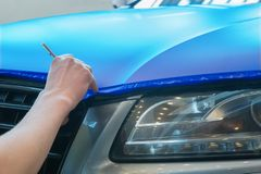 Pasting of car carbonic plastic. Closeup stock image