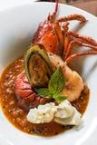 Pastis烤了被对分的龙虾仁 免版税库存图片