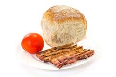 Pasto arrostito del bacon sul piatto Fotografia Stock Libera da Diritti