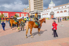 Free PASTO, COLOMBIA - JULY 3, 2016: Unidentified Woman With A Red Jacket Talking With A Police Officer Mounted On A Horse Stock Photography - 77169902