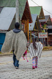 PASTO, COLOMBIA - JULY 3, 2016: man walking with a little girl dressed with traditional clothes in a small location in Stock Image