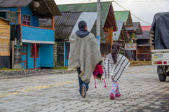 PASTO, COLOMBIA - JULY 3, 2016: native people with traditional clothes walking in the street in la cocha lake.  royalty free stock photo