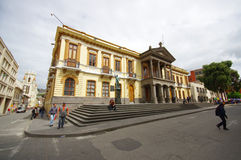 PASTO, COLOMBIA - JULY 3, 2016: outside view of the government building, some pedestrians walking on the street in front. Of the building Royalty Free Stock Photos