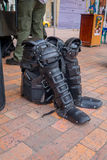 PASTO, COLOMBIA - JULY 3, 2016: police equipment standing on the floor next to a stand in the central square of the city Stock Images