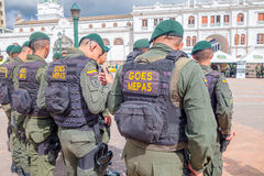 PASTO, COLOMBIA - JULY 3, 2016: police wearing uniform and lifejackets standing on the central square of the city.  stock photo