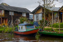 PASTO, COLOMBIA - JULY 3, 2016: small boat parked infront of some colorfull houses in la cocha lake.  stock image