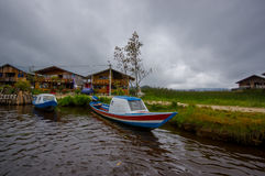 PASTO, COLOMBIA - JULY 3, 2016: some colorfull boats parked at the shore of la cocha lake Stock Photos