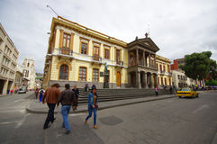 PASTO, COLOMBIA - JULY 3, 2016: some people crossing the street in front of the government building of the city Royalty Free Stock Photography
