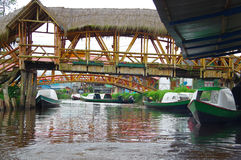 PASTO, COLOMBIA - JULY 3, 2016: some small boats parked on the river under some small wood bridges on la cocha lake Stock Photography