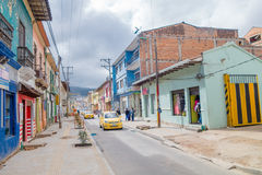 PASTO, COLOMBIA - JULY 3, 2016: some taxis driving trough the street in the city center Royalty Free Stock Images