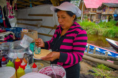 PASTO, COLOMBIA - JULY 3, 2016: unidentified woman adding some caramel to a wafer in a location close to la cocha lake Stock Photography