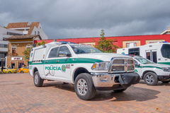 PASTO, COLOMBIA - JULY 3, 2016: white and green police pickup parked next to some othe police vehicles.  Royalty Free Stock Photos