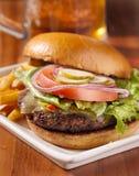 Pasto del cheeseburger Immagine Stock