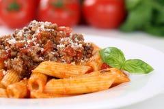 Pasto della pasta delle tagliatelle della salsa di Bolognaise o di Penne Rigate Bolognese Fotografia Stock