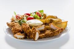 Pasto delle pepite di pollo Fotografia Stock