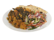 Pasto di Aloo Gobi Saag con insalata Fotografie Stock