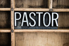 Pastor Concept Metal Letterpress Word in Drawer. The word PASTOR written in vintage metal letterpress type in a wooden drawer with dividers stock image
