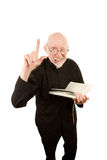 Pastor giving fiery sermon. Senior priest or pastor giving a fiery sermon from the Bible royalty free stock images