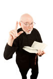 Pastor giving a fiery sermon. Senior pastor delivering fiery sermon and holding a Bible Stock Photos