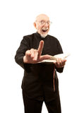 Pastor Giving a Fiery Sermon. Senior pastor giving a fiery sermon with Bible in hand royalty free stock photography