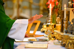 Pastor hands on altar. Pastor blesses the water of baptism royalty free stock photo