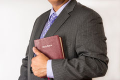 Pastor holding a Holy Bible. Pastor befora a sermon. Pastor ready to preach.Business man holding a Bible. Business man holding a Bible in the place of work. Man Stock Images