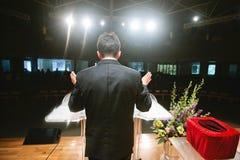 Pastor praying for congregation stock photos