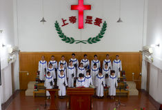The pastor preaching. Pastor preaching with choir  in church of longhai city on sunday, fujian province, china Royalty Free Stock Photos