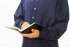 Pastor priest reading holy bible over white Stock Photos