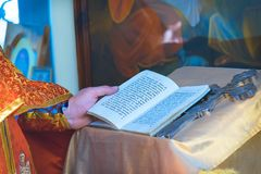 The pastor reads Psalm. Pastor reads a Psalm, a book in the old Slavic language royalty free stock image