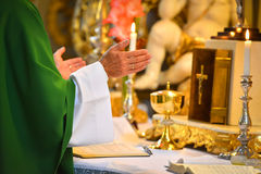 Pastor's hands in prayer. On church altar Stock Photography