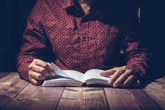Pastor studying the Bible on a wooden desk. Before the church service Royalty Free Stock Images
