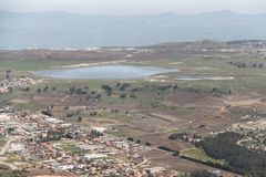 Pastoral Galilee Valley Landscape. With big lake in the middle, agriculture fields and houses Royalty Free Stock Images