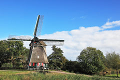 The windmill on the green hill Royalty Free Stock Image