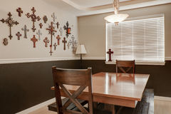 Pastoral style dining room. Crosses hanging on the wall Royalty Free Stock Photo