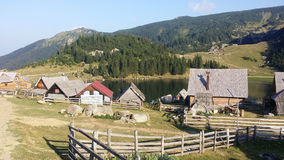 Pastoral Village and mountain lake Stock Image