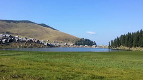 Pastoral Village and mountain lake Stock Photography
