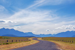 Pastoral winding country road and mountains in Fiordland, New Ze Stock Image