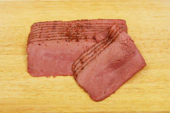Pastrami on a board Royalty Free Stock Image