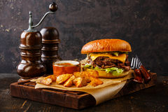 Pastrami Burger with sliced Roast beef and potato wedges Stock Photography