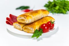 Pastrami and chicken rolls on white background stock image