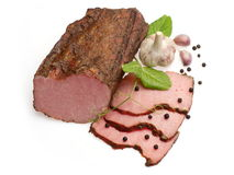 Pastrami decorated with garlic and black pepper stock image