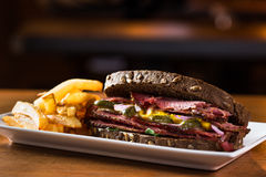 Pastrami. Delicious pastrami sandwich with french fries ready to eat Stock Photo