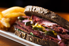 Pastrami. Delicious pastrami sandwich with french fries ready to eat Royalty Free Stock Photos